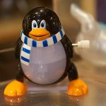 Picture of wind up Tux (Linux mascot) toy.